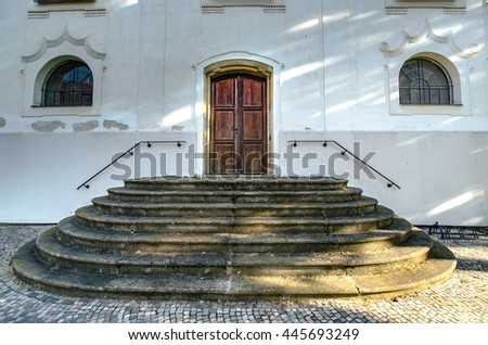 Old wooden door to the church - stock photo