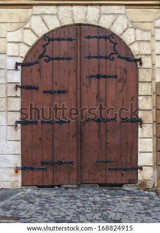 old wooden door town house in Prague - stock photo