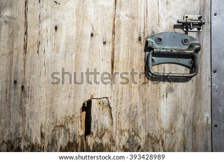 Old wooden door with a latch - stock photo