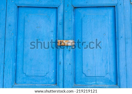 Old wooden door with blue color