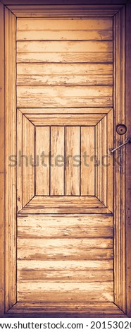 Old wooden door with handle