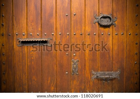 Old wooden door with mail box - stock photo