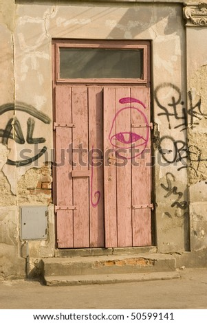 old wooden door with red and black graffiti - stock photo