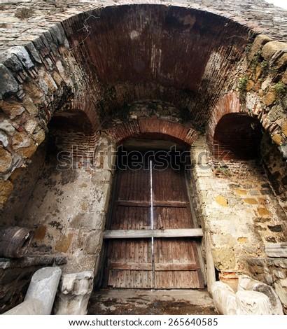 Old wooden doors in Rumeli Hisari ottoman castle in Istanbul, Turkey - stock photo