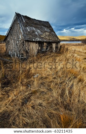 Old wooden farmhouse - stock photo