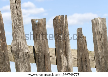 Old wooden fence closeup on sky background - stock photo