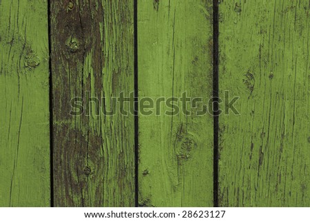 Old wooden fence. Green - stock photo