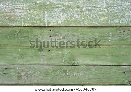 old wooden fence . green old wooden planks . green wooden wall . old green paint wooden planks . A horizontal green chalkboard . Green rustic fence . wooden table - stock photo