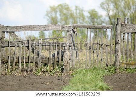 old wooden fence in the garden - stock photo