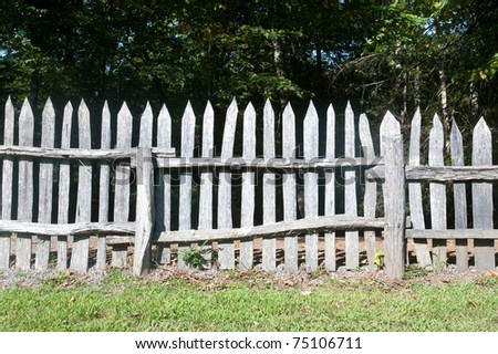 Old wooden fence on an old pasture - stock photo