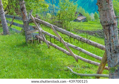 Old wooden fence on green meadow,Wooden fence, nature , a beautiful mountain landscape, Karpaty, Ukraine