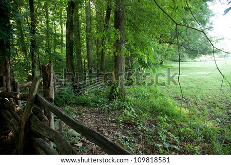 Old wooden fence to keep the wilds of nature out of the field