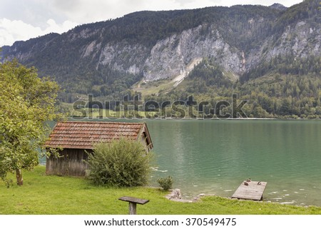 old wooden fisherman shed and platform on the shore of the mountain lake Mondsee in Alps, Austria - stock photo