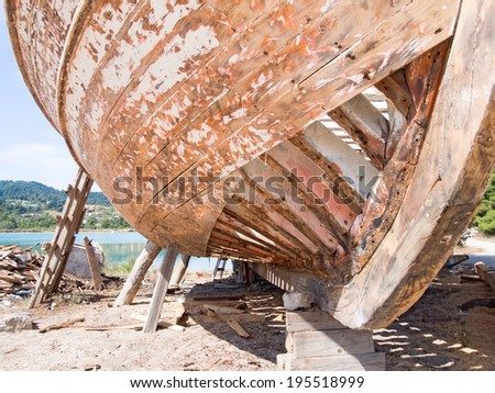 Old wooden fishing boat being restored - stock photo