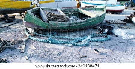 old wooden fishing boat in a harbour in la spezia - stock photo