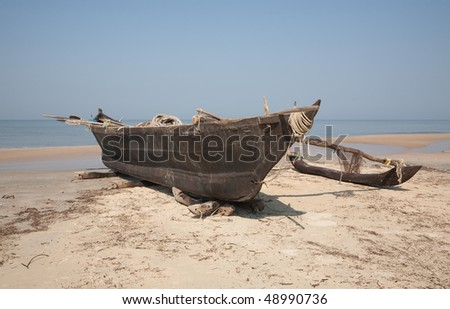 Old wooden fishing boat in the morning shore