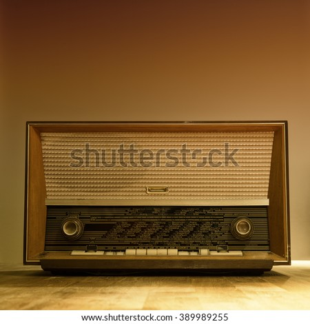 old wooden fm am radio with round adjusting knobs