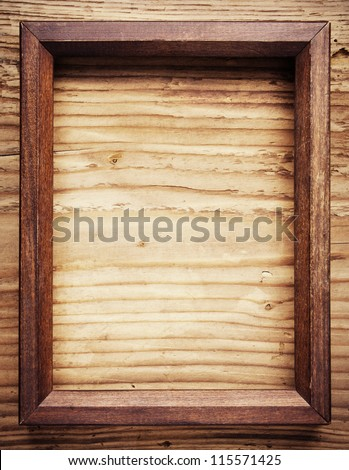 Old wooden frame on wood background - stock photo