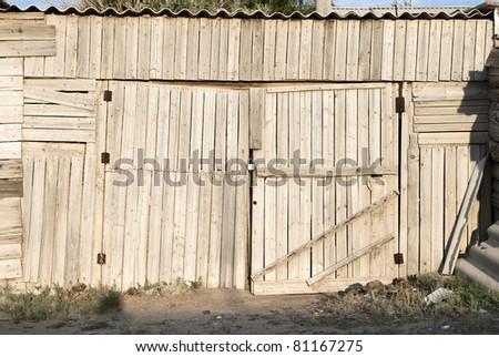 old wooden garage door - stock photo