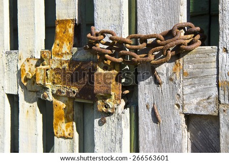 Old wooden gate closed with padlock - concept image - stock photo