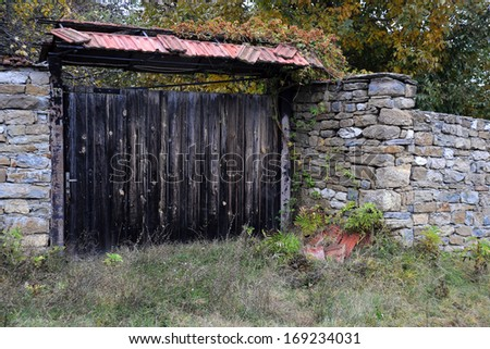 Old wooden gate in the Bulgarian village - stock photo