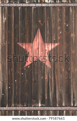 old wooden gate with soviet star - stock photo