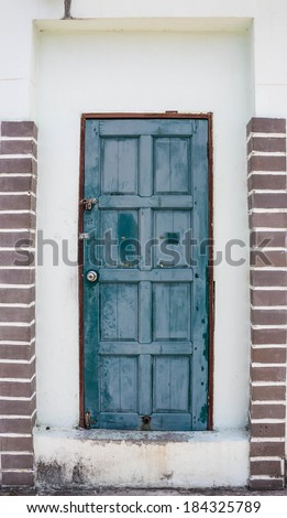 Old wooden gateway - stock photo