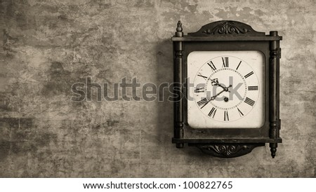 Old wooden grandfather clock hanging on a wall - stock photo