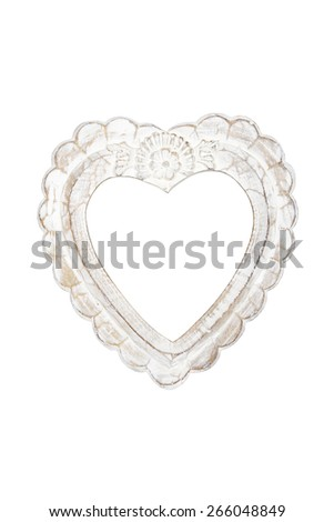 Old wooden heart picture frame isolated on white with clipping path. - stock photo