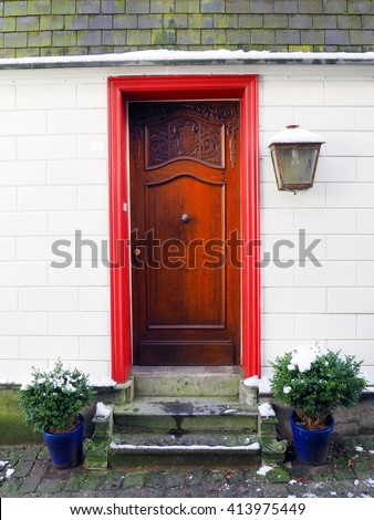 Old wooden house door in German village