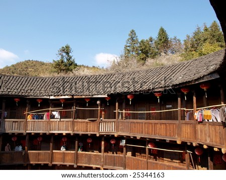 Old  wooden house in Chinese village which is called Tulou. - stock photo