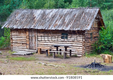 Old wooden house in the forest. - stock photo