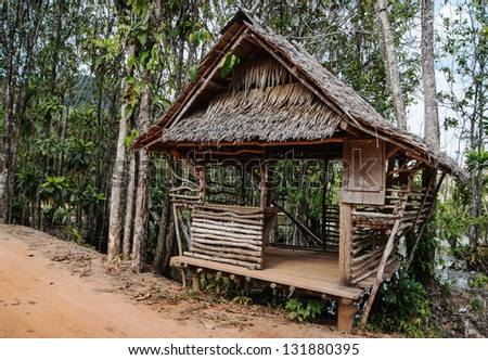 Old wooden house  in the tropics - stock photo