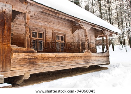 old wooden house in the winter forest - stock photo