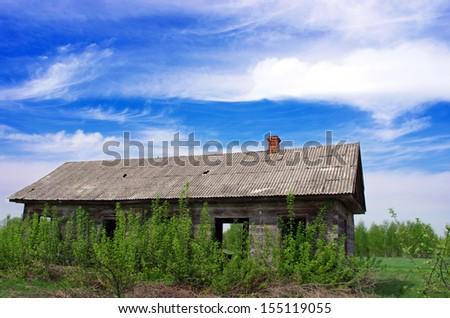 Old wooden house in ukrainien village - stock photo