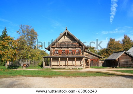 old wooden house in village - stock photo