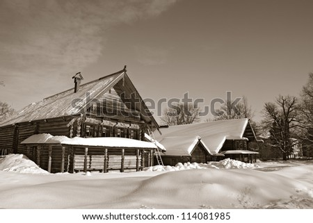 old wooden house in village , sepia - stock photo