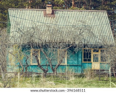 old wooden house, selective focus and toned image - stock photo