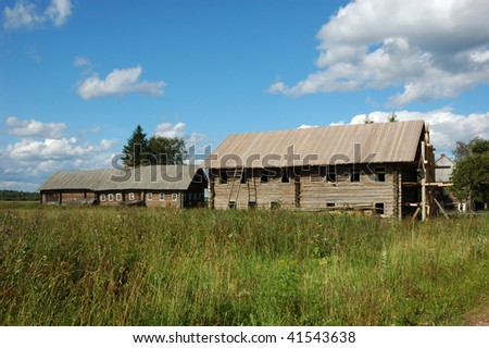 Old wooden house under construction in russian village Haluy, near Kargopol - stock photo