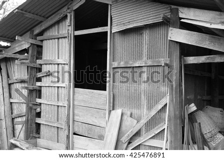 Old wooden house with Thai style in black and white tone - stock photo