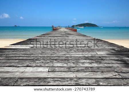 Old wooden jetty on exotic beach  island, Thailand - stock photo