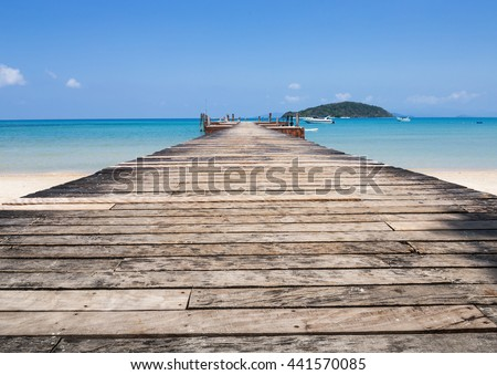 Old wooden jetty on exotic beach Koh Chang island, Thailand