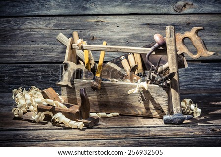 Old wooden joinery tool box - stock photo