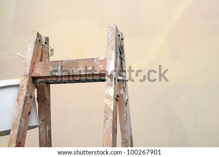 Old  wooden ladder ready for painting - stock photo