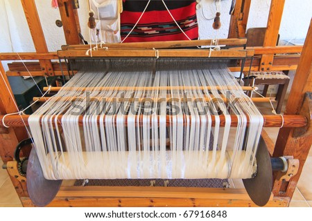 old wooden loom with strings of cloth - stock photo