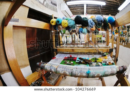 old wooden machine for produce traditional arabic rug - stock photo