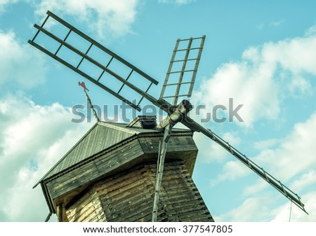 Old wooden mill on a background of the blue sky in Suzdal, Russia