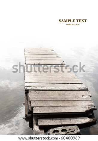 Old wooden mooring. Vertical photo - stock photo