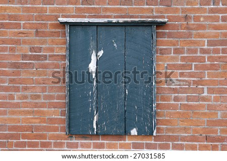 Old wooden notice board on a brick wall - stock photo