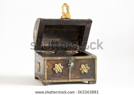 Old wooden open and empty chest on white - stock photo